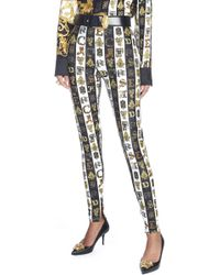 Versace - Logo Printed Striped leggings - Lyst