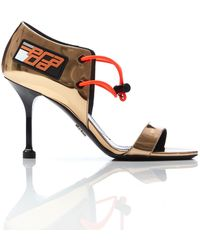 Prada - Gold Patent Leather High Heels - Lyst