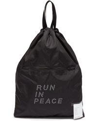 Satisfy - 'run In Peace' Slogan Print Drawstring Backpack - Lyst