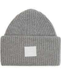 1f5d66f1de7 Lyst - Acne Studios Ribbed Wool Pansy Beanie Hat in Pink
