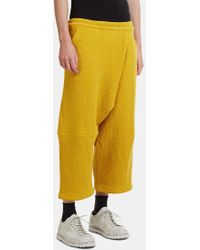 Anntian - Asymmetrical Cropped Honeycomb Drop Crotch Pants In Yellow - Lyst