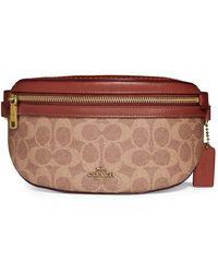 bdf3321d2db5 Michael Kors. Lillie Large Black Leather Messenger Bag. £240. Larizia ·  COACH - Signature Canvas Belt Bag - Lyst