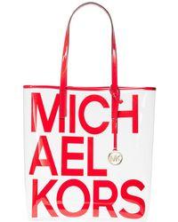 77e0d02006 MICHAEL Michael Kors - The Michael Large Graphic Logo Print Pvc Tote Bag -  Lyst