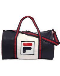 f83671eccb Fila - Color Block Logo Faux Leather Duffle Bag - Lyst
