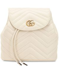 0201a60ec Gucci Women's GG Marmont Chevron Quilted Leather Mini Backpack - Hibiscus  Red - Lyst