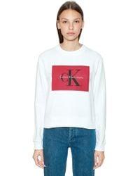 Calvin Klein Jeans - Cropped Logo Printed Cotton Sweatshirt - Lyst
