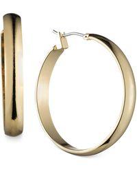 """Anne Klein - Gold-tone 1 1/4""""wide Hoop Earrings - Lyst"""