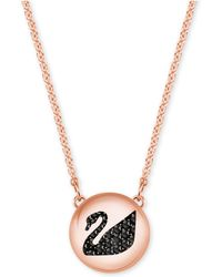 Swarovski - Rose Gold-tone Jet Crystal Swan Disc Pendant Necklace - Lyst
