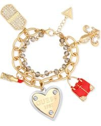 Guess - Gold-tone Double Strand Pavé Charm Bracelet - Lyst