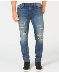 Sean John - Slim-straight Fit Stretch Ripped Jeans With Camo Repair Patches - Lyst