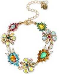 Betsey Johnson - Gold-tone Multi-stone Flower Flex Bracelet - Lyst