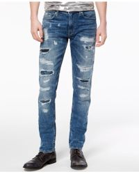 Guess - Slim Tapered Fit Stretch Jeans - Lyst