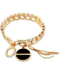 Guess - Gold-tone Crystal, Jet Stone & Tassel Charm Bracelet - Lyst