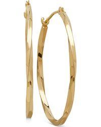 Macy's - Thin Twist Oval Hoop Earrings In 10k Gold, 1 Inch - Lyst