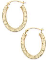 Macy's - Textured Oval Hoop Earrings In 10k Gold - Lyst