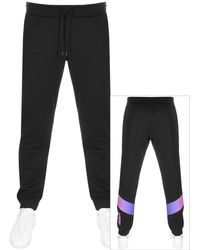 956f16aa8 adidas Originals Id95 Track Pants in Black for Men - Lyst