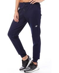 New Balance - Accelerate Tech Poly Fleece Cuffed Trousers Pigment Navy - Lyst