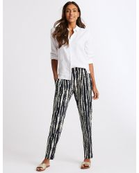 Marks & Spencer - Printed Jersey Tapered Leg Peg Trousers - Lyst