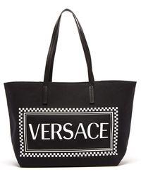 Versace - Logo Print Canvas Tote - Lyst