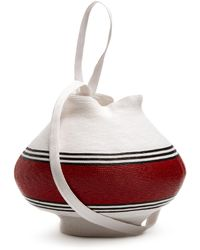 Rosie Assoulin - Striped Woven-straw Jug Bag - Lyst