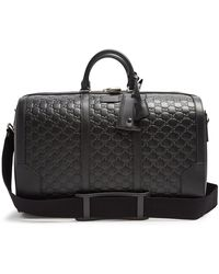 Gucci - Logo-debossed Leather Holdall - Lyst
