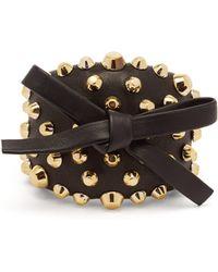 Prada - Bow And Stud Embellished Leather Cuff - Lyst