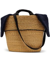 Muuñ - Geraldine Shearling And Woven Straw Bag - Lyst