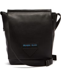 Prada - Logo Embossed Leather Cross Body Bag - Lyst