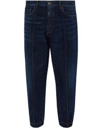 Prada - Gathered Cuff Tapered Jeans - Lyst