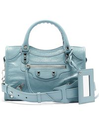 a98da4f229 Lyst - Balenciaga Poker Green Grained Leather Leather City 12 ...