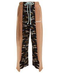 Natasha Zinko - Wide-leg Camouflage-print Cotton-blend Track Trousers - Lyst