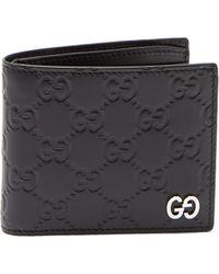 Gucci - GG-debossed Bi-fold Leather Wallet - Lyst
