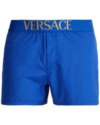 Versace - Logo Jacquard Swim Shorts - Lyst