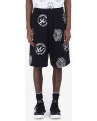 McQ - Skate Badge Printed Shorts - Lyst