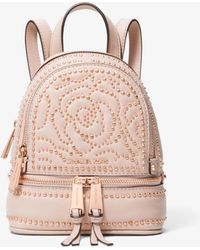 44a89ed4bc5c6 Michael Kors - Michael Rhea Mini Zip Studded Convertible Backpack - Lyst