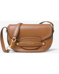 d3d6700ec449 Michael Kors Cary Fringed Suede Smartphone Crossbody Bag in Black - Lyst
