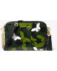 cf4d0d3e5e67 Lyst - Michael Kors Large Butterfly Camo Leather Dome Crossbody in Black