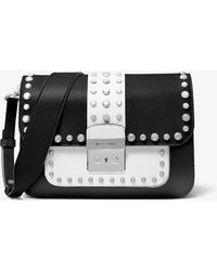 60b0a038c MICHAEL Michael Kors - Sloan Editor Studded Two-tone Leather Shoulder Bag -  Lyst