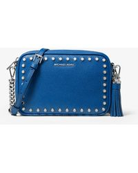50b13433bad2 MICHAEL Michael Kors - Ginny Medium Studded Pebbled Leather Crossbody Bag -  Lyst