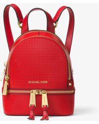 61e09b51388b Lyst - Michael Kors Rhea Mini Perforated Leather Backpack in Red