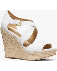 afd2e06c3d4e3 Michael Kors Jill Floral Sequined Leather Wedge in Black - Lyst