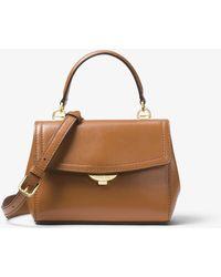 4235f50ee6e Lyst - Grand sac porté épaule Mott en cuir à motif logo façon ...