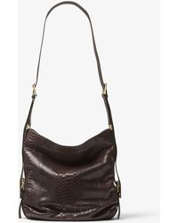 0c6d9d1ce46e0b Michael Kors Naomi Extra-large Woven Leather Shoulder Bag in Brown ...