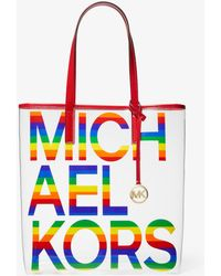 8ef5c6c4e61c MICHAEL Michael Kors - The Michael Large Graphic Logo Print Pvc Tote Bag -  Lyst