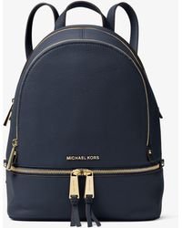 0c6f1596336c Lyst - Michael Kors Rhea Zip Medium Leather Backpack in Natural