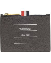 Thom Browne Black Paper Label Clutch In Leather With Golden Hardware And Front Print