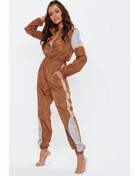 36e87559f19 Neon Green Colourblock Shell Jumpsuit. £35. Missguided · Missguided - Brown Colourblock  Shell Suit - Lyst