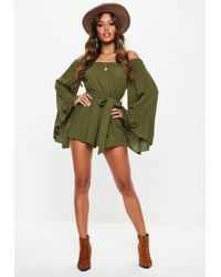 3f35da7cdc Lyst - Missguided Wrap Front Crepe Playsuit Khaki in Natural