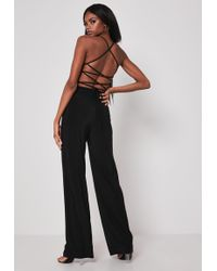 fddc5b7249b07f Missguided - Black Cut Out Strappy Jumpsuit - Lyst