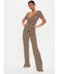 fca26ba52f09 Missguided Tie Front T-shirt Jumpsuit Nude in Natural - Lyst